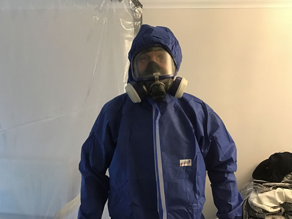 Suited up ready for asbestos removal